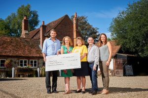 Brakspear & Marie Curie members of staff presenting the cheque