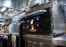 On the plate with the MIBRASA charcoal oven from Ascentia