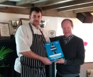 PubAid co-founder Des O'Flanagan (right) presents a World's Biggest Pub Quiz pack to Will Shaw, licensee at the Crown Inn, Sydenham, Oxfordshire